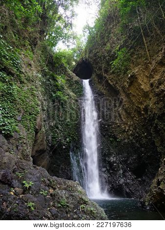 Waterfall In Green Rainforest. Waterfall In The Mountain Jungle. Bali, Indonesia. Travel Concept.