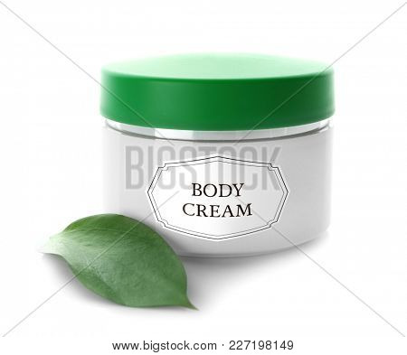 Jar with body cream and green leaf on white background