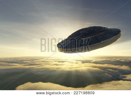 3d Illustration Of Alien Spacecraft Is Flying Over The Clouds Against Sunset