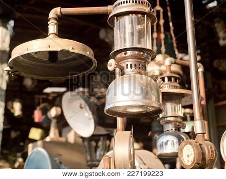 An Old, Vintage Lamp With A Shade In An Antique Store. Antiquarian Shop With Old Ancient Lamps. Anti