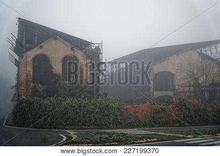 Old House With A Ghost On The Road In The Morning Horror House In Fog. Old Mystic Building In Dead T