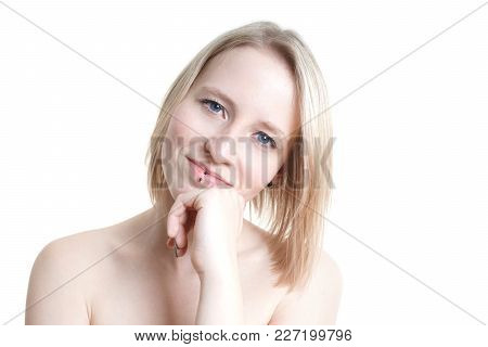 Portrait Of A Blue-eyed Blonde Young Woman With Pale Skin From Germany Isolated On White