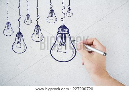 Hand Drawing Creative Lamp Sketch On Concrete Wall Background. Idea, Innovation And Finance Concept