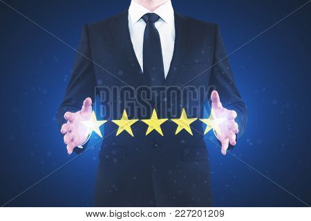 Businessman Rating Hotel On Blurry Background. Performance And Quality Concept