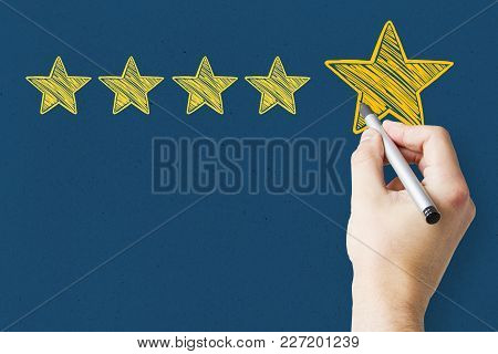 Businessman Pointing At Abstract Stars On Blue Background. Experience Rating And Classification Conc