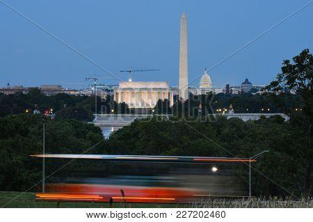 Washington DC skyline with tourist bus in motion blur - Washington DC United States
