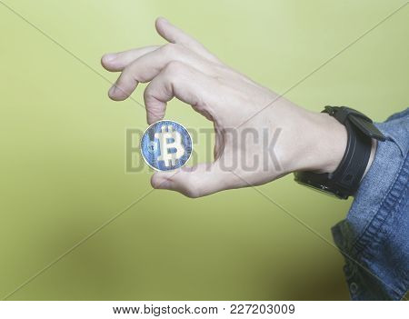 Virtual Blue Coins Bitcoins Holding Hand On Yellow