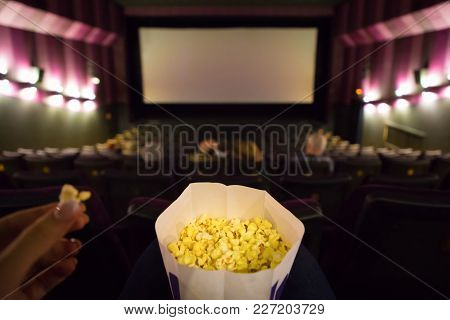 Cinema Hall With Big Screen And Pop Corn In Woman Hand