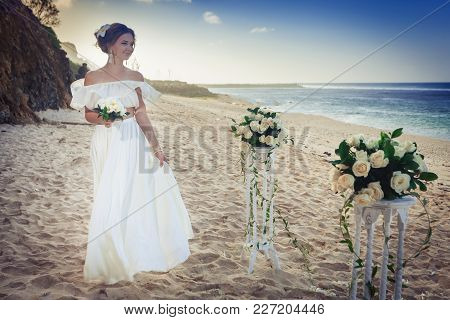 Beautiful Bride Married At The Beach, Bali. Wedding Ceremony, Bridal Bouquet