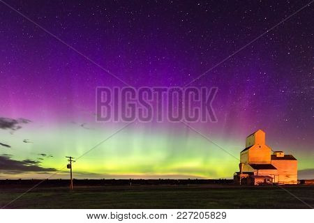 Aurora Borealis Northern Lights Over A Historic Grain Elevator In Pennant, Saskatchewan, Canada