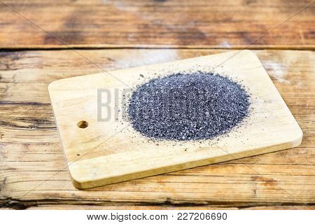 Black Salt On Wooden Board. Wood Background