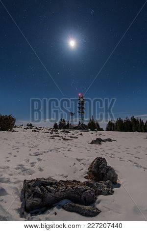 Transmitter Station Tower On Snow Covered Mountain Schoeckl With Moon And Stars In The Sky