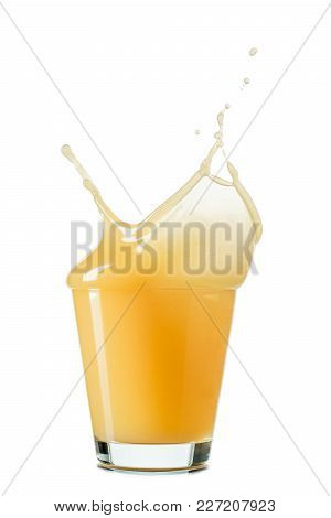 Splash Of Apple Or Quince Juice In A Glass Isolated On White Background.