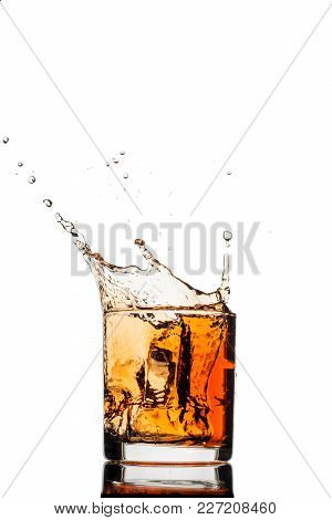 Splash Of Whiskey With Ice Isolated On White Background