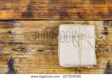 Gift Wrapped Kraft Paper On Wooden Background
