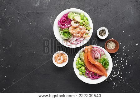 Fresh Seafood Recipe. Shrimp Salmon Poke Bowl With Fresh Prawn, Brown Rice, Cucumber, Pickled Sweet