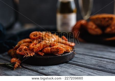 Seafood Shrimp. Close-up Of Ready-made Shrimps Lie In Plate, Dark Background. In Background, Crab Ha