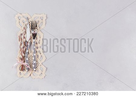 Easter Table Setting. Cutlery, Lace Napkin And Pussy Willow Twigs On Light Stone Concrete Background