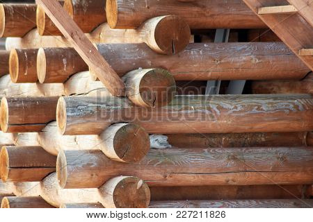 Closeup View Of Corner Of Wooden House Made Of Natural Logs - Wooden Construction Background, Nature