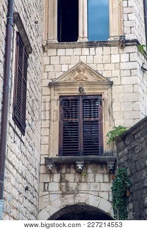 Old Building In Montenegro With Windows And Shutters And Ivy