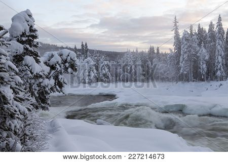 Cold Winter Morning. Rapids This Side Snowy And Covered Trees. Daybreak.