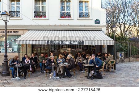 Paris, France, February 17, 2018: The Cafe Au Petit Montmartre Is A Traditional French Cafe In The M