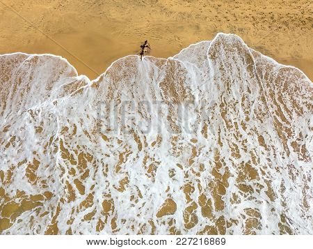 Three Tourists Are Relaxing On The Beach In Thiranagama On Sri Lanka. Aerial Horizontal Photo.