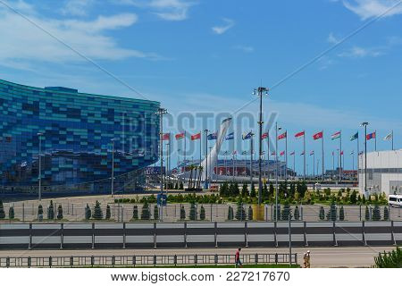Russia, Sochi, Krasnodar Region-june 12.2017: Square In The Olympic Park With Festive Flags Of Diffe