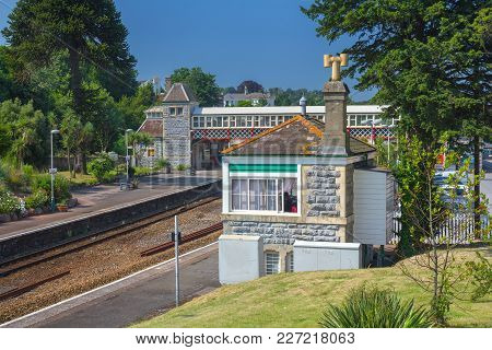Railway Station In The City Of Torquay. A Pedestrian Crossing Was Made Through The Rails. Sunny Day.