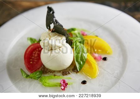 Burrata - Italian Cheese, Which Is An Excellent Combination Of Mozzarella And Cream. Its Name Comes