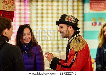Lisbon, Portugal - January, 2018. A Shop Worker In A Steampunk Uniform Tells Customers About The Con