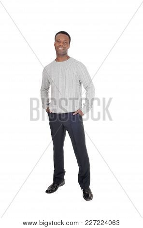 A Tall Good Looking African American Man Standing In Dress Pants And A Gray Sweater From The Front,