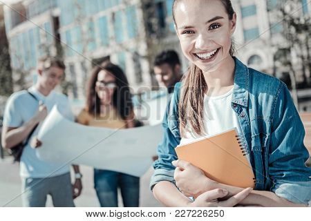 Absolute Happiness. Happy Positive Female Student Smiling And Expressing Her Emotions While Holding