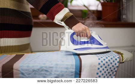 Housewife Work, A Housewife Does Her Job, Iron And Ironing Board, Ironing