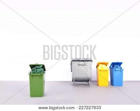 Colorful Recycle Bins On White And Gray Background. Recycling Concept.