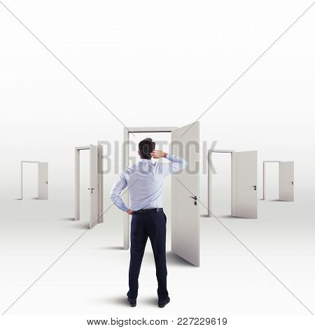 Undecided Businessman In The Choice Of The Right Door That Leads To Success