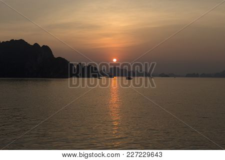 Sunset In Halong Bay In Summer Time With Boats
