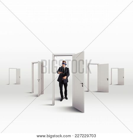 Blindfolded Businessman In The Choice Of The Right Door That Leads To Success