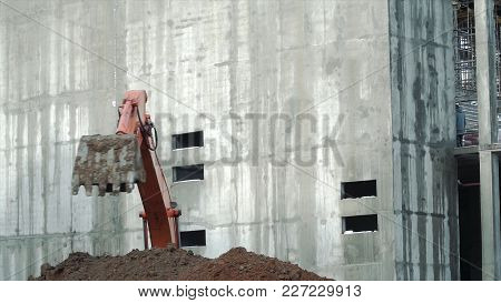 Loader Backhoe, Excavator Digging A Trench. Clip. Work Of Excavating Machine On Building Constructio