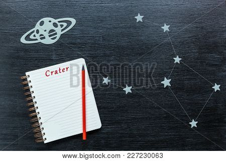 Zodiacal Star, Constellations Crater On A Black Background With A Notepad And Pencil.