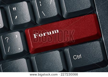 Close-up View Of Conceptual Black Keyboard. Red Button With Inscription Forum. Internet Forum And Di
