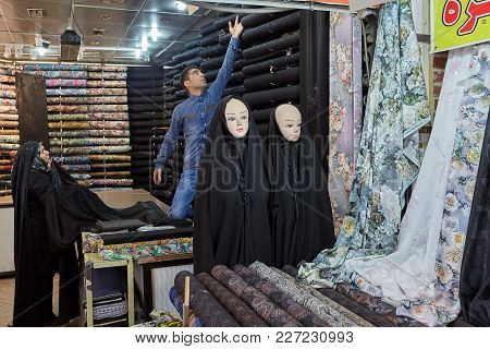 Tehran, Iran - April 29, 2017: An Elderly Muslim Woman Chooses A Cloth For A Religious Veil In The D
