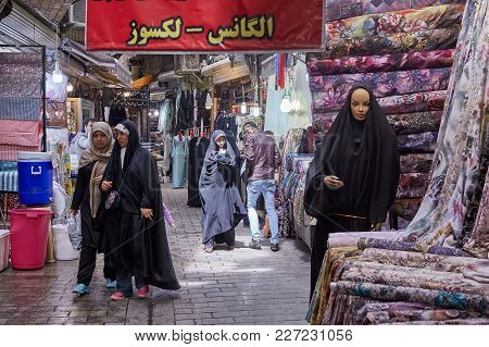 Tehran, Iran - April 29, 2017: Shoppers Walk Through Fabrics Department At The Oriental Bazaar.