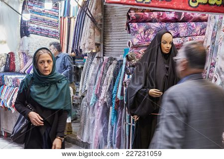 Tehran, Iran - April 29, 2017: Departments With Clothes And Fabrics On The Tehran Grand Bazaar, Buye
