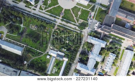 Aerial View Of A Modern And Clean City With Lots Greenery And White Buildings. Clip. Top View Of The