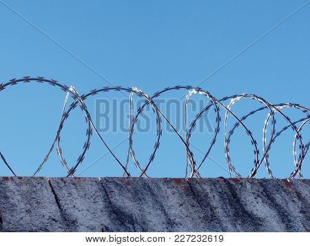 Safety And Danger: Wall With Spiral Barbed Wire, Razor Wire Fencing