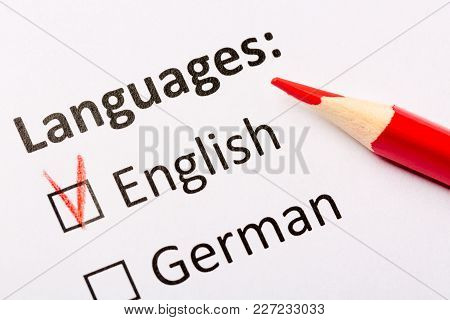 Questionnaire Concept. Languages With English And German Checkboxes With Red Pencil. Close Up Image.