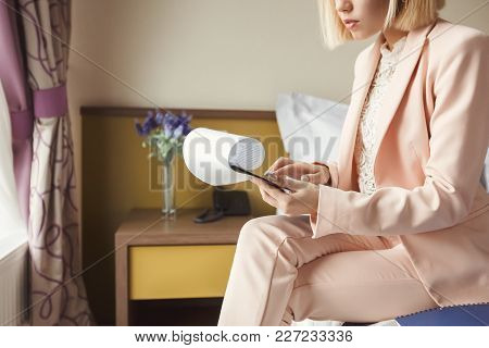Unrecognizable Businesswoman Reading Documents. Female Professional In Hotel Examining Papers. Busin