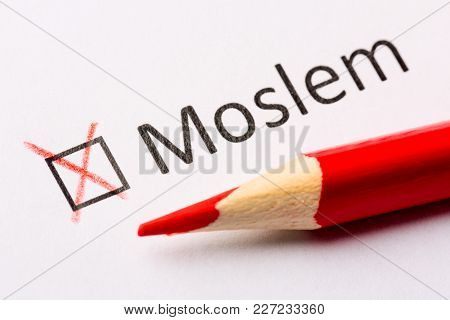 Questionnaire Concept. Religious Interrogation. Red Pencil And The Inscription Moslem With Cross On