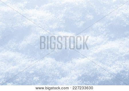 Snow Surface Texture Background. Crystals And Snowflakes. Winter Natural Background